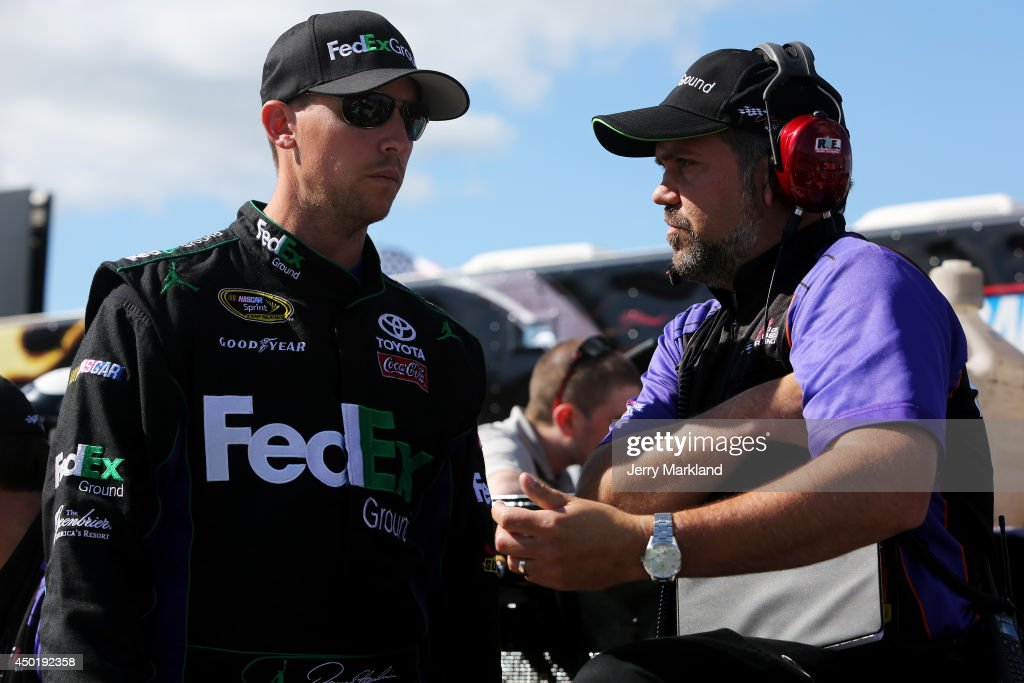 <a gi-track='captionPersonalityLinkClicked' href=/galleries/search?phrase=Denny+Hamlin&family=editorial&specificpeople=504674 ng-click='$event.stopPropagation()'>Denny Hamlin</a> (left), driver of the #11 FedEx Ground Toyota, stands on the grid with Darian Grubb, crew chief of the #11 FedEx Ground Toyota, during qualifying for the NASCAR Sprint Cup Series Pocono 400 at Pocono Raceway on June 6, 2014 in Long Pond, Pennsylvania.