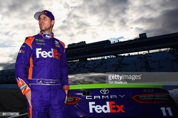 Denny Hamlin driver of the FedEx Ground Toyota stands on the grid during qualifying for the Monster Energy NASCAR Cup Series ISM Connect 300 at New...