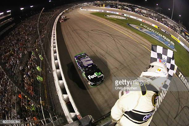 Denny Hamlin driver of the FedEx Ground Toyota takes the checkered flag to win the NASCAR Sprint Cup Series Federated Auto Parts 400 at Richmond...