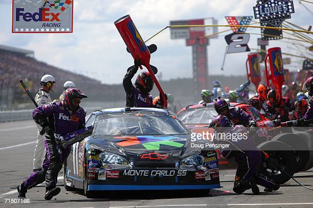 Denny Hamlin driver of the FedEx Kinko's Chevrolet pulls in for a pit stop during the NASCAR Nextel Cup Series Pennsylvania 500 on July 23 2006 at...
