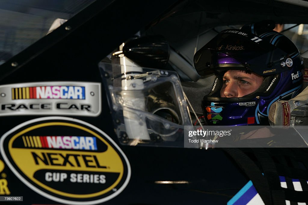 Denny Hamlin driver of the FedEx Kinko's Chevrolet sits in his car during qualifying for the NASCAR Nextel Cup Series Subway Fresh Fit 500 at Phoenix...