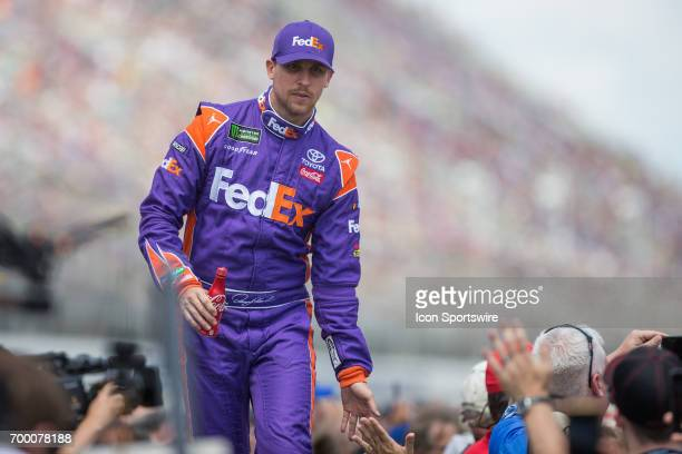 Denny Hamlin driver of the FedEx Office Toyota greets fans during the driver introductions ceremony prior to the start of the Monster Energy Cup...