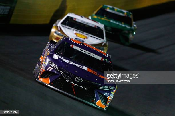 Denny Hamlin driver of the FedEx Office Toyota leads a pack of cars during the Monster Energy NASCAR Cup Series CocaCola 600 at Charlotte Motor...