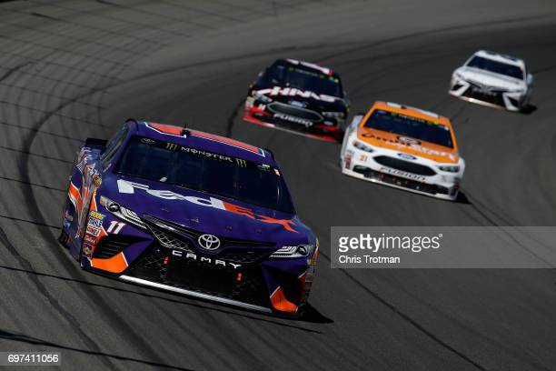 Denny Hamlin driver of the FedEx Office Toyota leads a pack of cars during the Monster Energy NASCAR Cup Series FireKeepers Casino 400 at Michigan...