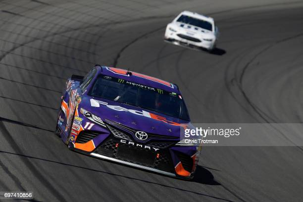 Denny Hamlin driver of the FedEx Office Toyota leads Brad Keselowski driver of the Miller Lite Ford during the Monster Energy NASCAR Cup Series...