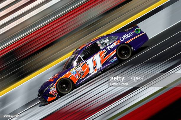 Denny Hamlin driver of the FedEx Office Toyota practices for the Monster Energy NASCAR Series CocaCola 600 at Charlotte Motor Speedway on May 27 2017...