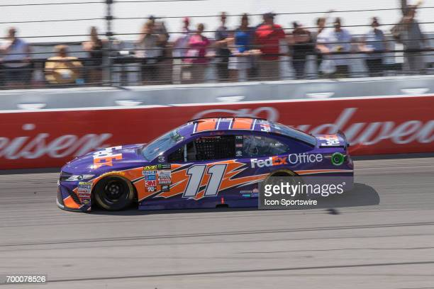 Denny Hamlin driver of the FedEx Office Toyota races during the Monster Energy Cup Series Firekeepers Casino 400 race on June 18 2017 at Michigan...