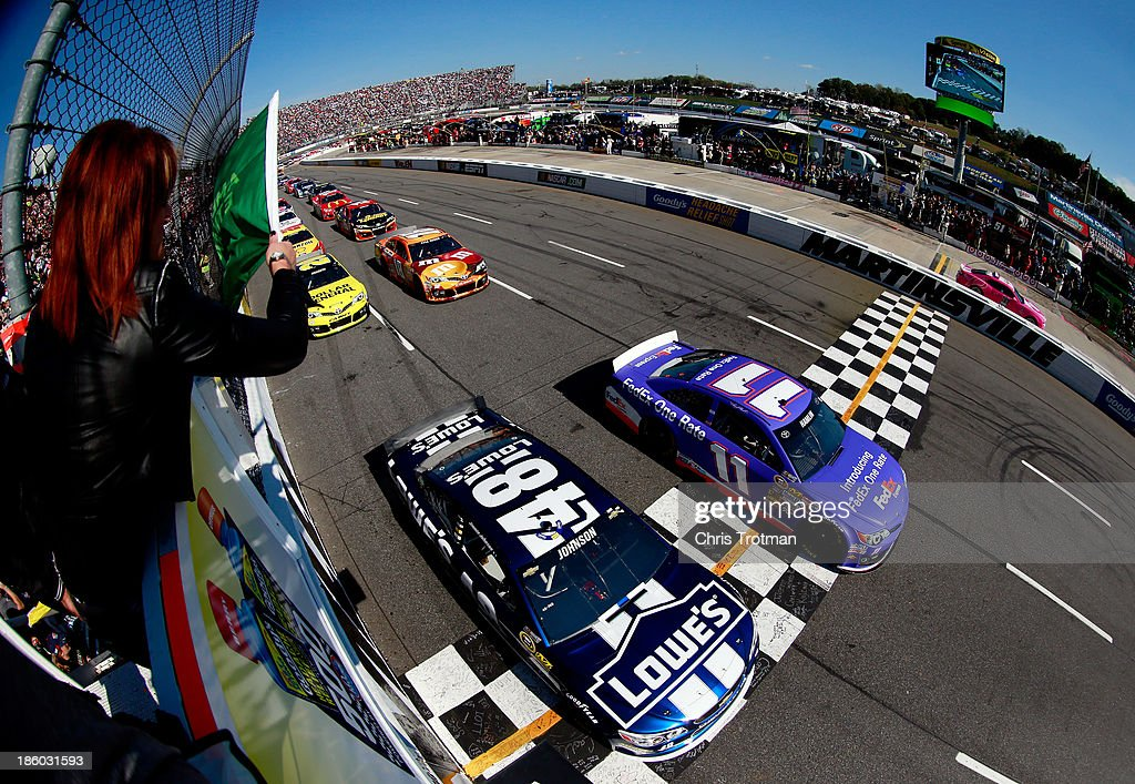 <a gi-track='captionPersonalityLinkClicked' href=/galleries/search?phrase=Denny+Hamlin&family=editorial&specificpeople=504674 ng-click='$event.stopPropagation()'>Denny Hamlin</a>, driver of the #11 FedEx One Rate Toyota, and Jimmie Johnson, driver of the #48 Lowe's Chevrolet, lead the field to start the NASCAR Sprint Cup Goody's Headache Relief Shot 500 Powered By Kroger at Martinsville Speedway on October 27, 2013 in Martinsville, Virginia.