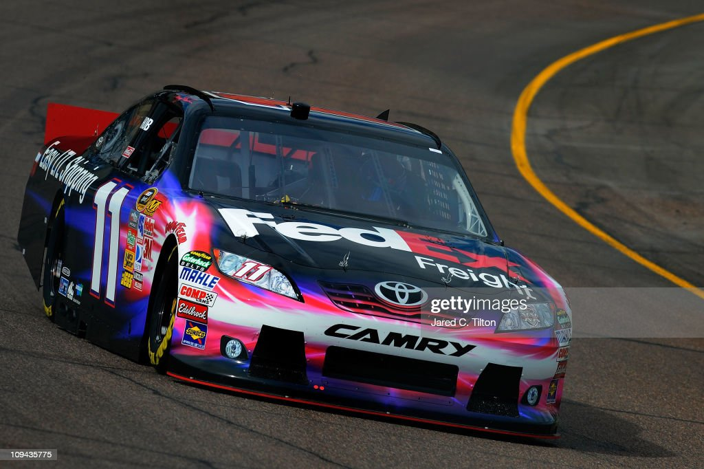 Denny Hamlin driver of the FedEx Toyota practices for the Subway Fresh Fit 500 at Phoenix International Raceway on February 25 2011 in Avondale...