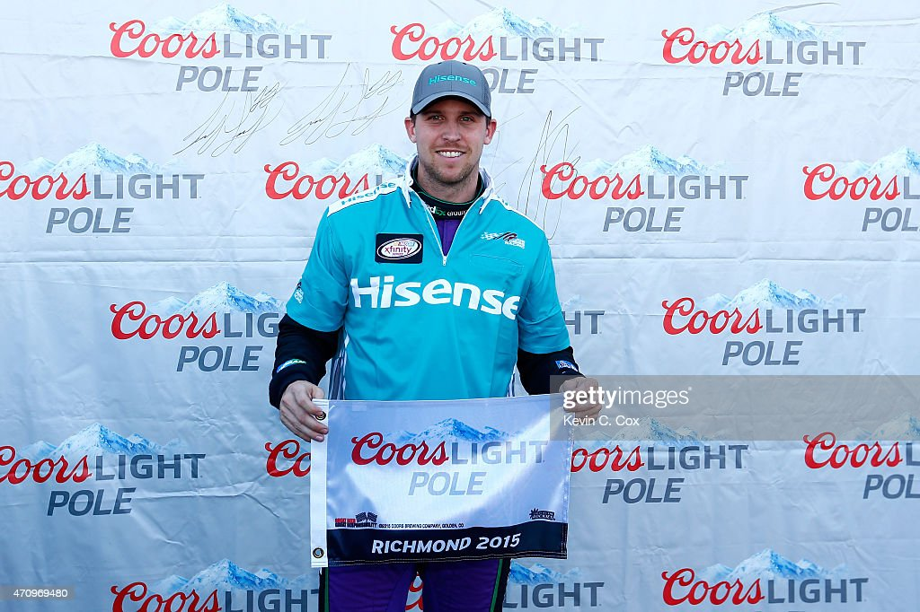 <a gi-track='captionPersonalityLinkClicked' href=/galleries/search?phrase=Denny+Hamlin&family=editorial&specificpeople=504674 ng-click='$event.stopPropagation()'>Denny Hamlin</a>, driver of the #20 Hisense Toyota, celebrates after winning the Coors Light Pole Award for the NASCAR XFINITY Series ToyotaCare 250 at Richmond International Raceway on April 24, 2015 in Richmond, Virginia.