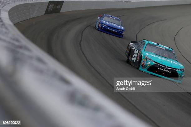 Denny Hamlin driver of the Hisense Toyota leads Elliott Sadler driver of the OneMain Financial Chevrolet during the NASCAR XFINITY Series Irish Hills...
