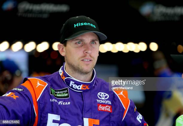Denny Hamlin driver of the Hisense Toyota stands in the garage during practice for the NASCAR Xfinity Series Hisense 4K TV 300 at Charlotte Motor...