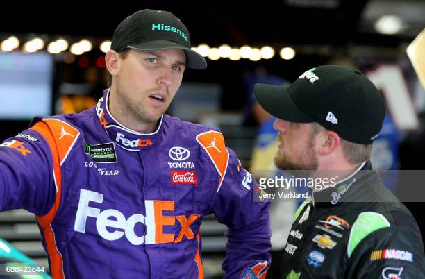 Denny Hamlin driver of the Hisense Toyota talks to Justin Allgaier driver of the Breyers Chevrolet during practice for the NASCAR Xfinity Series...