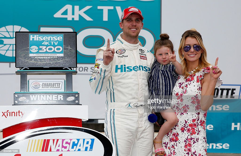 <a gi-track='captionPersonalityLinkClicked' href=/galleries/search?phrase=Denny+Hamlin&family=editorial&specificpeople=504674 ng-click='$event.stopPropagation()'>Denny Hamlin</a>, driver of the #18 Hisense USA Toyota, celebrates in Victory Lane with his girlfriend, Jordan Fish, and daughter, Taylor, during the NASCAR XFINITY Series Hisense 300 at Charlotte Motor Speedway on May 28, 2016 in Charlotte, North Carolina.