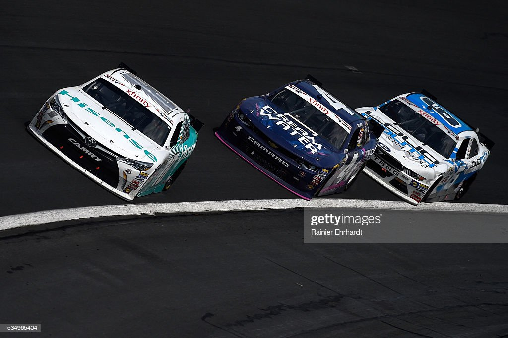 <a gi-track='captionPersonalityLinkClicked' href=/galleries/search?phrase=Denny+Hamlin&family=editorial&specificpeople=504674 ng-click='$event.stopPropagation()'>Denny Hamlin</a>, driver of the #18 Hisense USA Toyota, leads a pack of cars during the NASCAR XFINITY Series Hisense 300 at Charlotte Motor Speedway on May 28, 2016 in Charlotte, North Carolina.