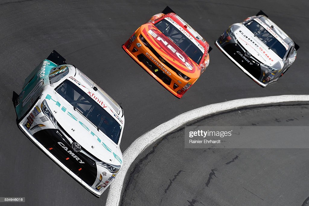 <a gi-track='captionPersonalityLinkClicked' href=/galleries/search?phrase=Denny+Hamlin&family=editorial&specificpeople=504674 ng-click='$event.stopPropagation()'>Denny Hamlin</a>, driver of the #18 Hisense USA Toyota, leads <a gi-track='captionPersonalityLinkClicked' href=/galleries/search?phrase=Kyle+Larson+-+Race+Car+Driver&family=editorial&specificpeople=2115989 ng-click='$event.stopPropagation()'>Kyle Larson</a>, driver of the #42 ENEOS Chevrolet, and <a gi-track='captionPersonalityLinkClicked' href=/galleries/search?phrase=Erik+Jones+-+Race+Car+Driver&family=editorial&specificpeople=13494574 ng-click='$event.stopPropagation()'>Erik Jones</a>, driver of the #20 GameStop Toyota, during the NASCAR XFINITY Series Hisense 300 at Charlotte Motor Speedway on May 28, 2016 in Charlotte, North Carolina.