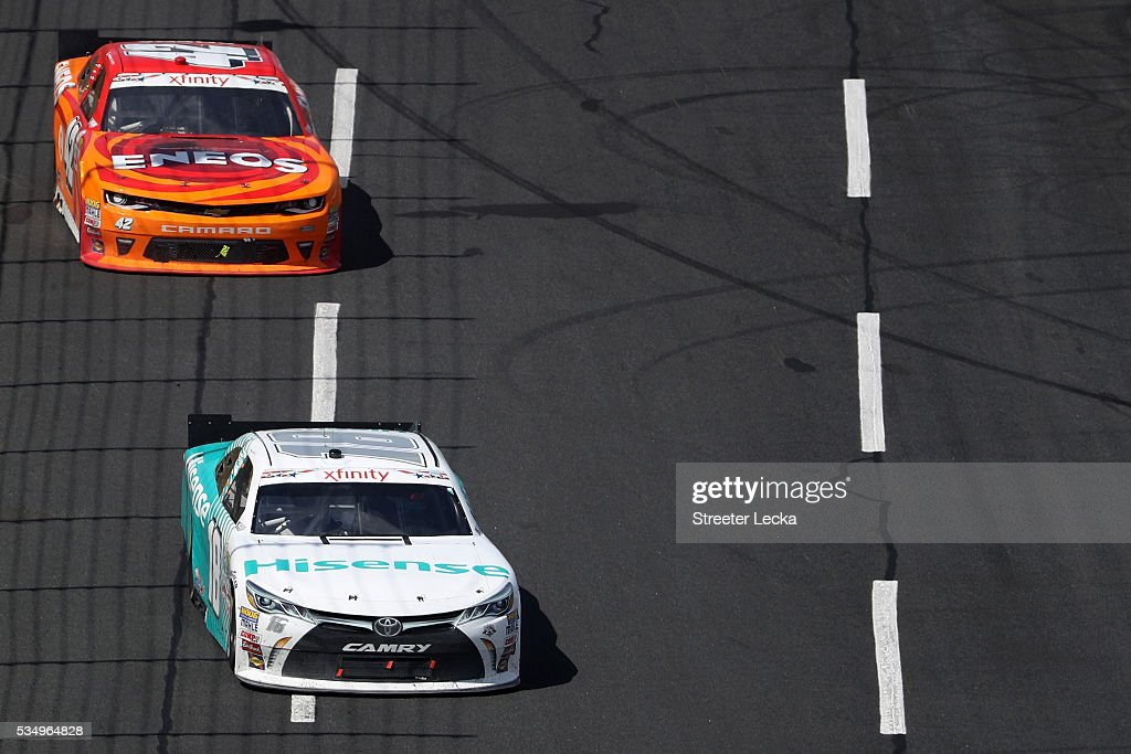 <a gi-track='captionPersonalityLinkClicked' href=/galleries/search?phrase=Denny+Hamlin&family=editorial&specificpeople=504674 ng-click='$event.stopPropagation()'>Denny Hamlin</a>, driver of the #18 Hisense USA Toyota, leads <a gi-track='captionPersonalityLinkClicked' href=/galleries/search?phrase=Kyle+Larson+-+Race+Car+Driver&family=editorial&specificpeople=2115989 ng-click='$event.stopPropagation()'>Kyle Larson</a>, driver of the #42 ENEOS Chevrolet, during the NASCAR XFINITY Series Hisense 300 at Charlotte Motor Speedway on May 28, 2016 in Charlotte, North Carolina.