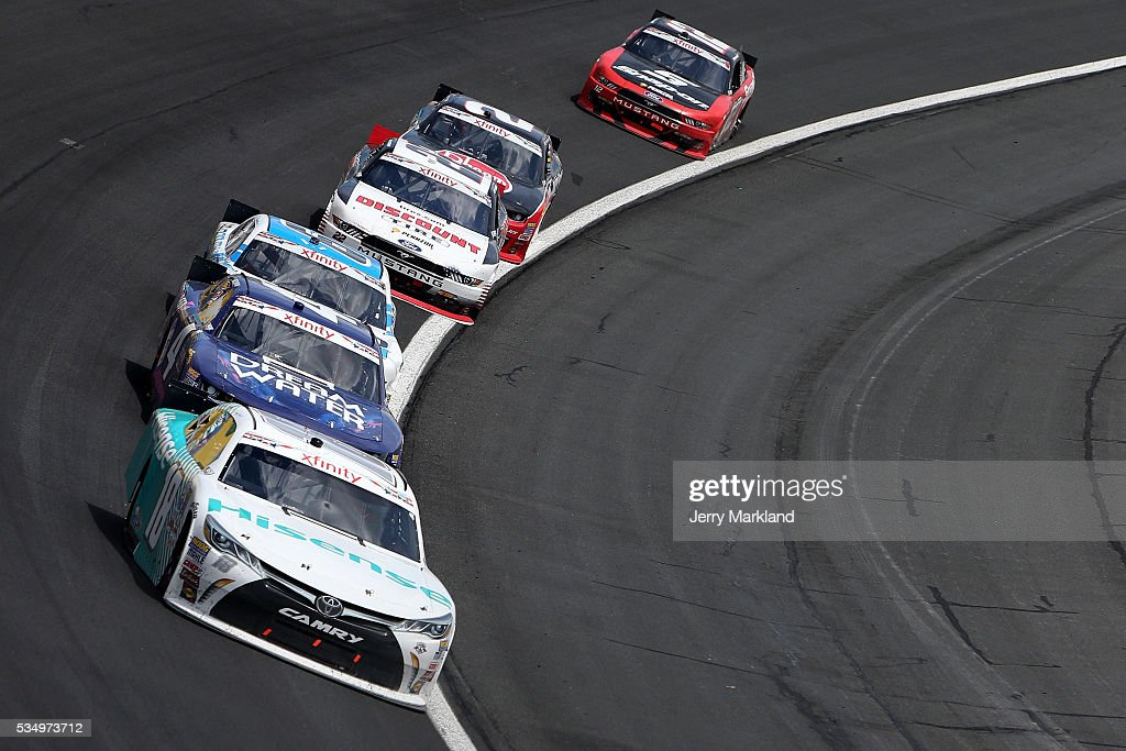 <a gi-track='captionPersonalityLinkClicked' href=/galleries/search?phrase=Denny+Hamlin&family=editorial&specificpeople=504674 ng-click='$event.stopPropagation()'>Denny Hamlin</a>, driver of the #18 Hisense USA Toyota, races during the NASCAR XFINITY Series Hisense 300 at Charlotte Motor Speedway on May 28, 2016 in Charlotte, North Carolina.