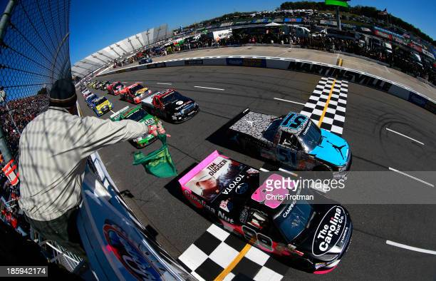 Denny Hamlin driver of the Jordan Brand Toyota and Johnny Sauter driver of the Carolina Nut/Curb Records Toyota lead the field to start the NASCAR...