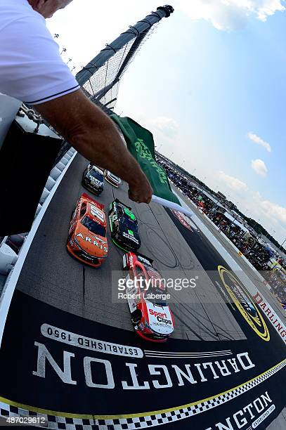 Denny Hamlin driver of the Sport Clips Toyota and Daniel Suarez driver of the ARRIS Toyota lead the field to the green flag for the running of the...