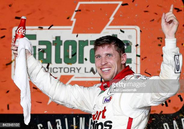 Denny Hamlin driver of the Sport Clips Toyota celebrates in Victory Lane after winning the Monster Energy NASCAR Cup Series Bojangles' Southern 500...
