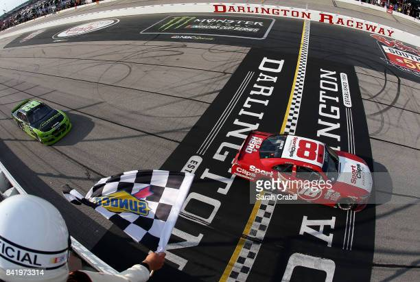 Denny Hamlin driver of the Sport Clips Toyota crosses the finish line to win the NASCAR XFINITY Series Sports Clips Haircuts VFW 200 at Darlington...