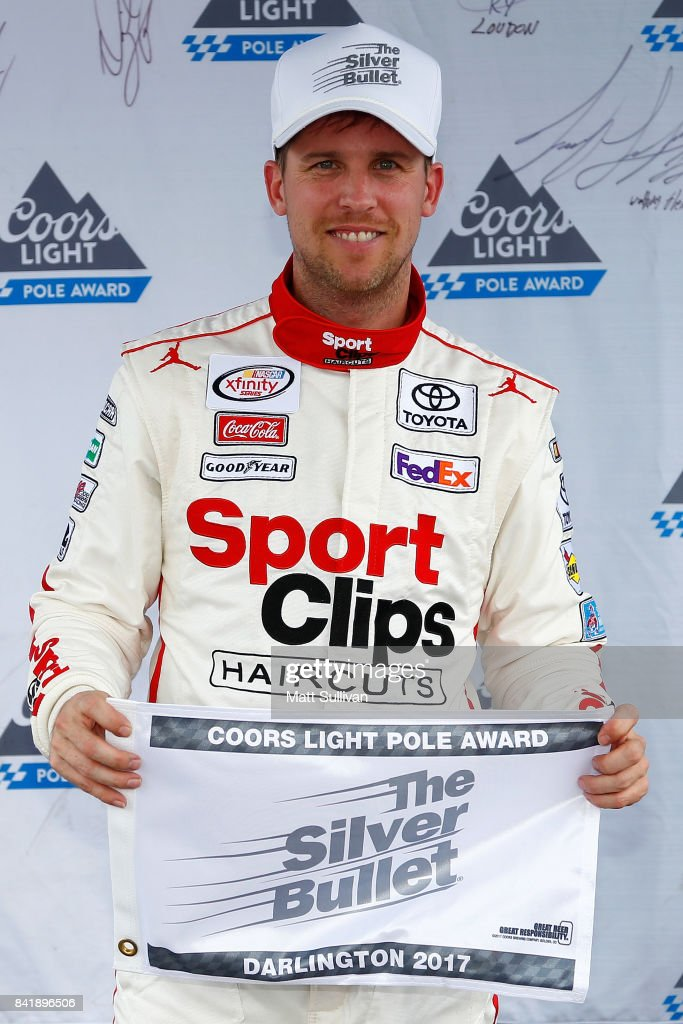 Denny Hamlin, driver of the #18 Sport Clips Toyota, poses with the Coors Light Pole Award after qualifying in the pole position for the NASCAR XFINITY Series Sports Clips Haircuts VFW 200 at Darlington Raceway on September 2, 2017 in Darlington, South Carolina.