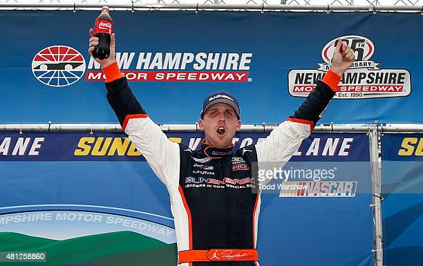 Denny Hamlin driver of the Sun Energy 1 Toyota celebrates in Victory Lane after winning the NASCAR XFINITY Series Lakes Region 200 at New Hampshire...