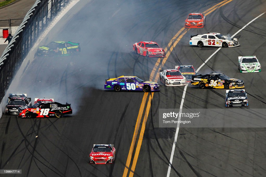 <a gi-track='captionPersonalityLinkClicked' href=/galleries/search?phrase=Denny+Hamlin&family=editorial&specificpeople=504674 ng-click='$event.stopPropagation()'>Denny Hamlin</a>, driver of the #18 Z-Line Designs Toyota, T.J. Bell, driver of the #50 Eastbound & Down Ford, and <a gi-track='captionPersonalityLinkClicked' href=/galleries/search?phrase=Ryan+Truex&family=editorial&specificpeople=5943617 ng-click='$event.stopPropagation()'>Ryan Truex</a>, driver of the #36 Tommy Baldwin Racing Chevrolet, spin while cars scatter to avoid the wreckage during the NASCAR Nationwide Series DRIVE4COPD 300 at Daytona International Speedway on February 25, 2012 in Daytona Beach, Florida.