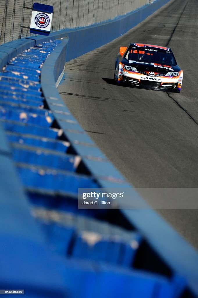 <a gi-track='captionPersonalityLinkClicked' href=/galleries/search?phrase=Denny+Hamlin&family=editorial&specificpeople=504674 ng-click='$event.stopPropagation()'>Denny Hamlin</a> drives the #11 FedEx Express Toyota during qualifying for the NASCAR Sprint Cup Series Auto Club 400 at Auto Club Speedway on March 22, 2013 in Fontana, California.