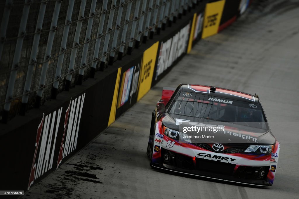 <a gi-track='captionPersonalityLinkClicked' href=/galleries/search?phrase=Denny+Hamlin&family=editorial&specificpeople=504674 ng-click='$event.stopPropagation()'>Denny Hamlin</a> drives the #11 FedEx Freight Toyota during qualifying for the NASCAR Sprint Cup Series Food City 500 at Bristol Motor Speedway on March 14, 2014 in Bristol, Tennessee.