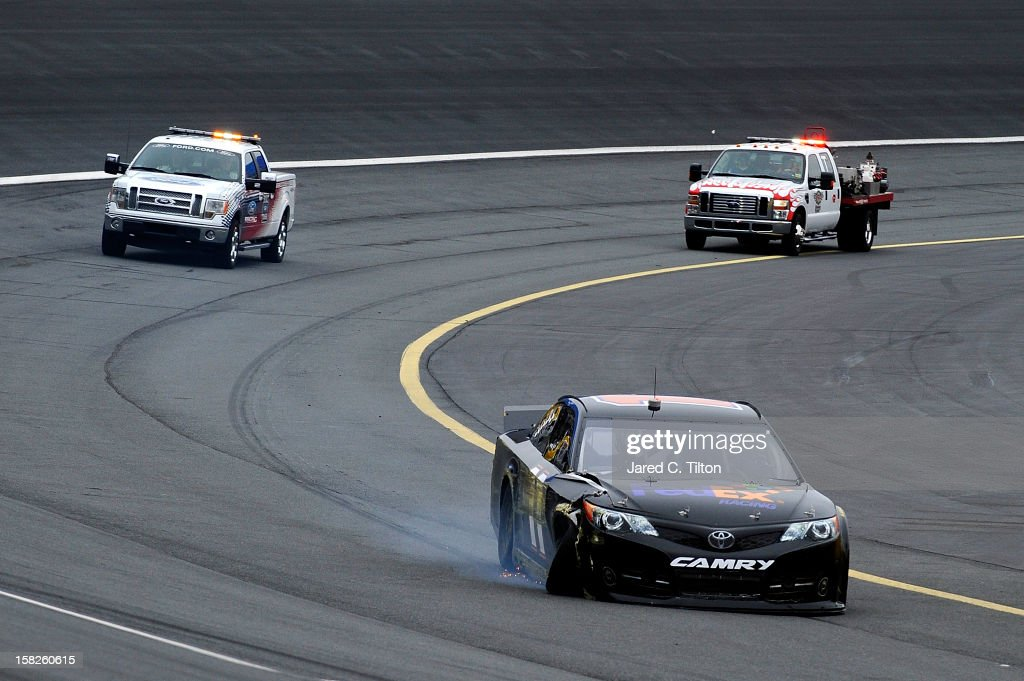 <a gi-track='captionPersonalityLinkClicked' href=/galleries/search?phrase=Denny+Hamlin&family=editorial&specificpeople=504674 ng-click='$event.stopPropagation()'>Denny Hamlin</a> drives the #11 FedEx Toyota after an incident during testing at Charlotte Motor Speedway on December 12, 2012 in Concord, North Carolina.