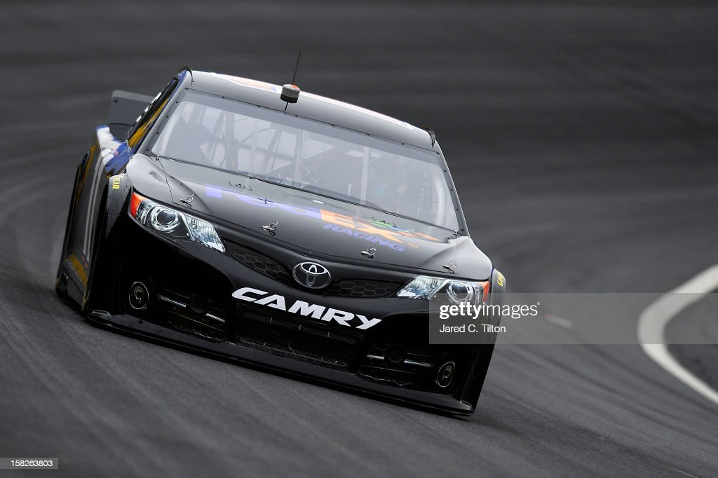 <a gi-track='captionPersonalityLinkClicked' href=/galleries/search?phrase=Denny+Hamlin&family=editorial&specificpeople=504674 ng-click='$event.stopPropagation()'>Denny Hamlin</a> drives the #11 FedEx Toyota during testing at Charlotte Motor Speedway on December 12, 2012 in Concord, North Carolina.