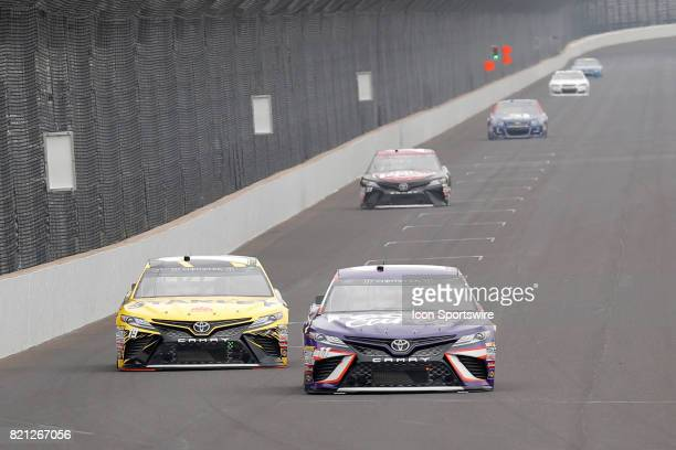 Denny Hamlin Joe Gibbs Racing Toyota Camry and Daniel Suarez Joe Gibbs Racing Toyota Camry head down the front stretch during practice for the NASCAR...
