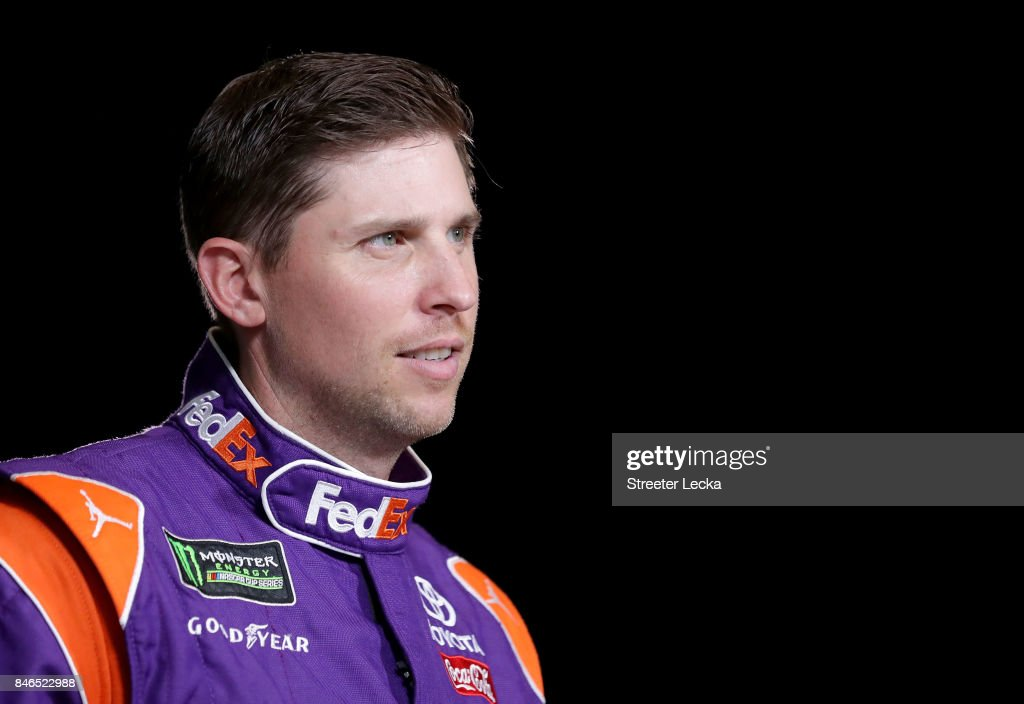 Denny Hamlin speaks to the media as one of the 16 drivers eligible to win the Monster Energy NASCAR Cup Series Championship during the 2017 NASCAR Playoffs Production & Media Day at NASCAR Hall of Fame on September 13, 2017 in Charlotte, North Carolina.