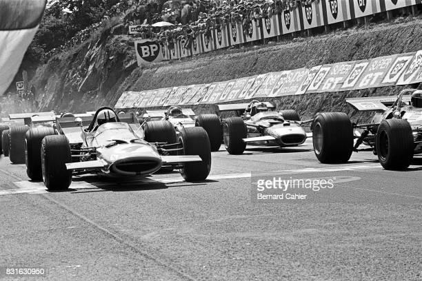 Denny Hulme Jochen Rindt JeanPierre Beltoise Jackie Stewart McLarenFord M7A Lotus 49B MatraFord MS80 Grand Prix of France Circuit de Charade...