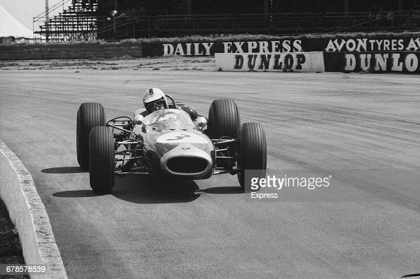 Denny Hulme of New Zealand drives the Brabham Racing Organisation Brabham BT22 Climax L4 during practise for the XVIII BRDC International Trophy on...