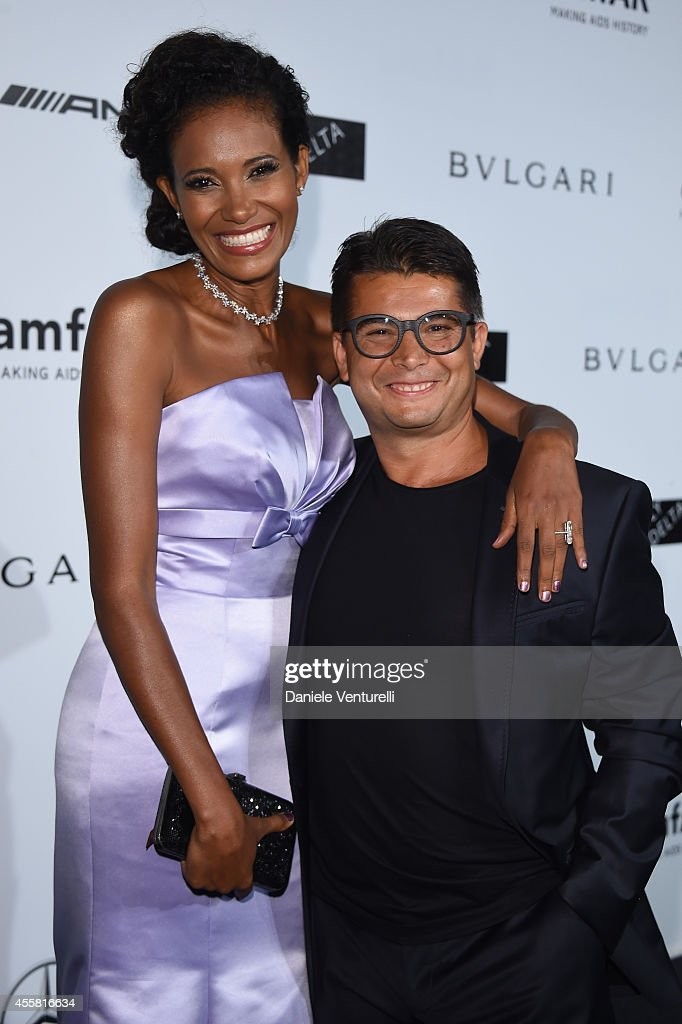 Denny Mendez and <a gi-track='captionPersonalityLinkClicked' href=/galleries/search?phrase=Oscar+Generale&family=editorial&specificpeople=6539852 ng-click='$event.stopPropagation()'>Oscar Generale</a> attend amfAR Milano 2014 as a part of Milan Fashion Week Womenswear Spring/Summer 2015 on September 20, 2014 in Milan, Italy.