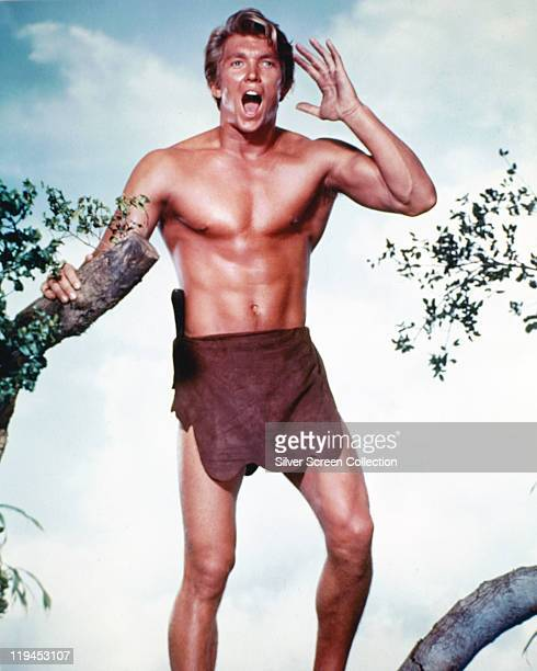 Denny Miller US actor wearing a loin cloth and calling out with a cupped hand to the side of his mouth in a publicity portrait issued for the film...
