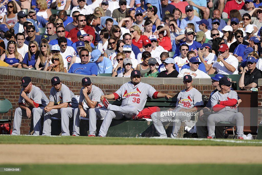 Denny Reyes #36 of the St. Louis Cardinals pops a bubble while sitting in the bullpen with other members of the Cardinals relief staff during the game against the Chicago Cubs on May 29, 2010 at Wrigley Field in Chicago, Illinois. The Cubs defeated the Cardinals 5-0.