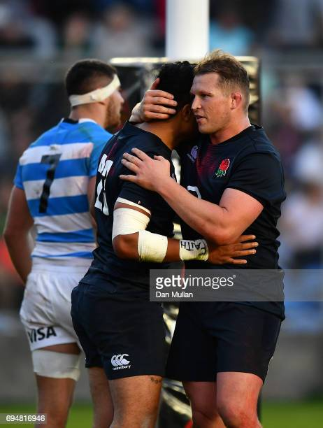 Denny Solomona of England embraces Dylan Hartley of England after scoring the winning try during the ICBC Cup match between Argentina and England at...
