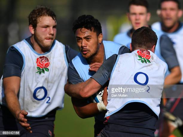 Denny Solomona of England is tackled by George Ford of England during a training session at San Isidro Club on June 7 2017 in Buenos Aires Distrito...