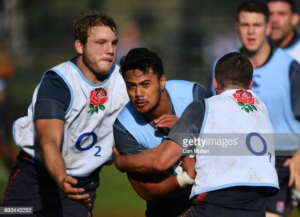 Denny Solomona of England is tackled by Joe Launchbury and George Ford of England during a training session at San Isidro Club on June 7 2017 in...