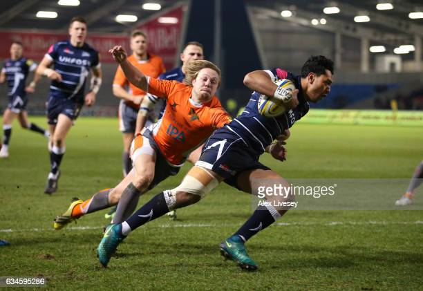 Denny Solomona of Sale Sharks beats Joel Hodgson of Newcastle Falcons to score a try during the Aviva Premiership match between Sale Sharks and...
