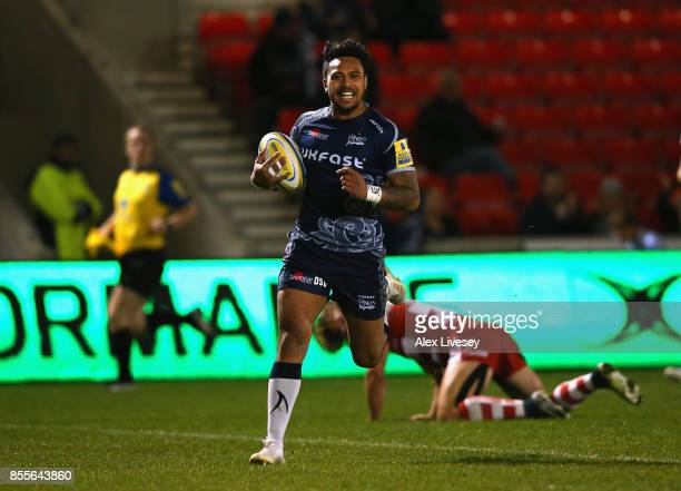 Denny Solomona of Sale Sharks breaks through to score his second try during the Aviva Premiership match between Sale Sharks and Gloucester Rugby at...