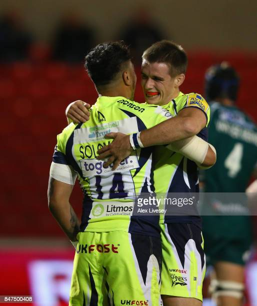 Denny Solomona of Sale Sharks celebrates scoring his first try with AJ MacGinty during the Aviva Premiership match between Sale Sharks and London...