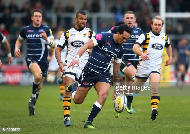 Denny Solomona of Sale Sharks chases a loose ball under pressure from Kurtley Beale of Wasps during the Aviva Premiership match between Sale Sharks...