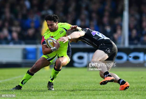 Denny Solomona of Sale Sharks is tackled by James Short of Exeter Chiefs during the Aviva Premiership match between Exeter Chiefs and Sale Sharks at...