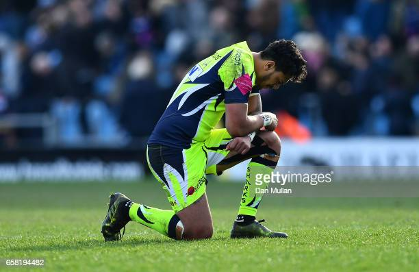 Denny Solomona of Sale Sharks prays following the final whistle during the Aviva Premiership match between Exeter Chiefs and Sale Sharks at Sandy...