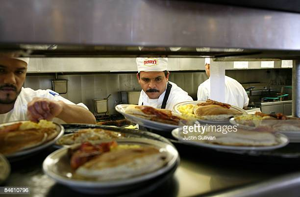 Denny's cooks prepare free Grand Slam breakfast plates February 3 2009 in Emeryville California People lined up at Denny's across North America today...